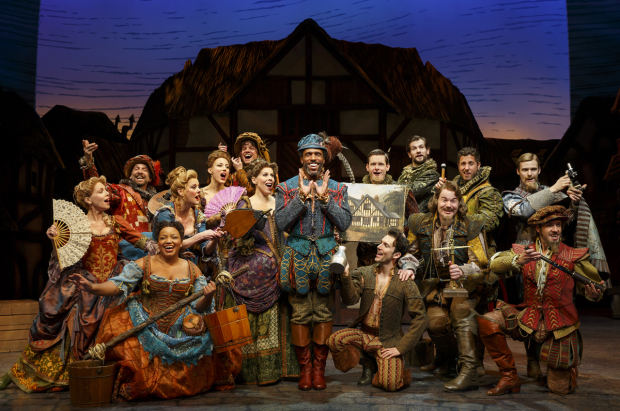 <p>André Ward (center) hosts the festivities as Minstrel in the Broadway cast.</p><br />(© Joan Marcus)