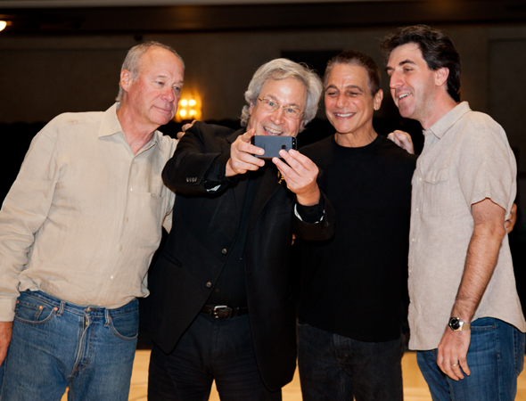<p>Andrew Bergman (left) and Jason Robert Brown (right) move from phone conversations to selfie-taking with record producer Jeffrey Lesser (second from left) and <em>Honeymoon</em> star Tony Danza.</p><br />(© Seth Walters)