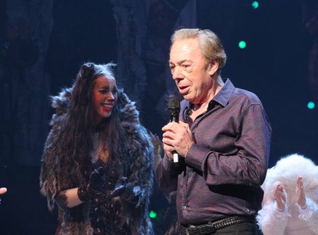 <p>Andrew Lloyd Webber takes the stage as Leona Lewis looks on.</p><br />(© David Gordon)