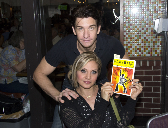 <p>Andy Karl and Orfeh put their John Hancocks on a piece of memorabilia from the show that brought them together, <em>Saturday Night Fever</em>.</p><br />(© David Gordon)