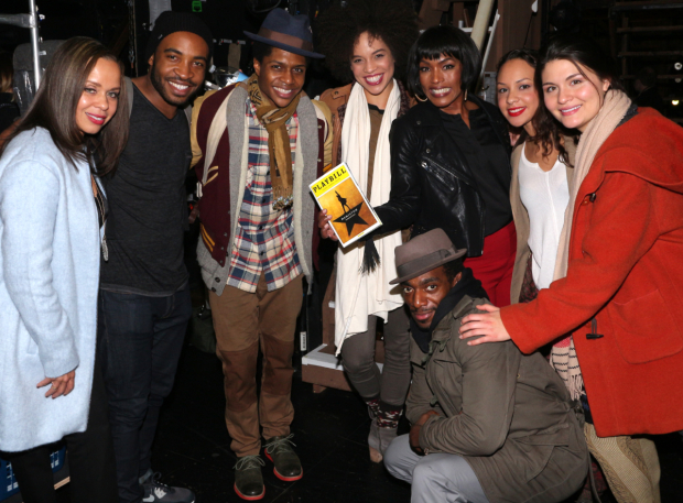 <p>Angela Bassett (third from right) and her pal Allison Hixson (left), takes a group shot with several <em>Hamilton</em> cast members.</p><br />(© David Gordon)