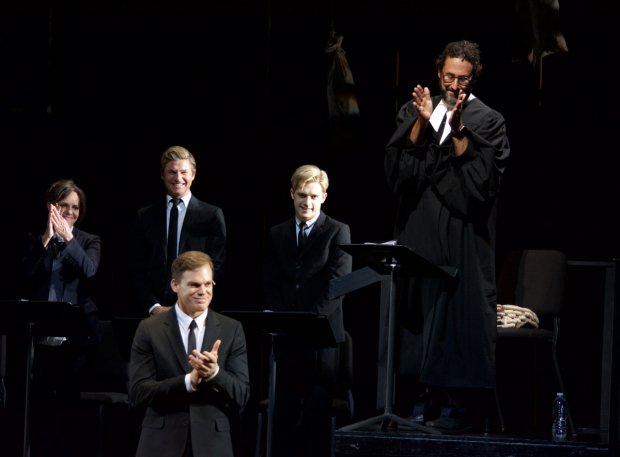<p><em>Angels in America</em> playwright Tony Kushner (standing right) gives his fellow cast members a standing ovation.</p><br />(© Kristin Goehring)