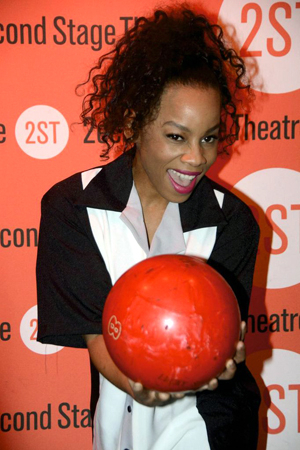 <p>Anika Noni Rose strikes a pose with her bowling ball.</p><br />(© Nessie Nankivell)