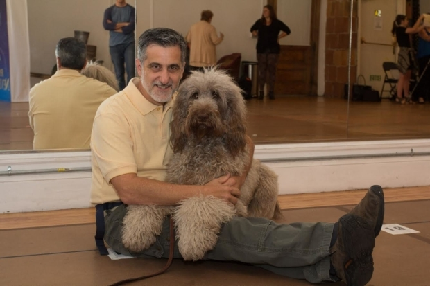 <p>Animal trainer Bill Berloni shows off the fluffy pup who will take <em>Finding Neverland</em> on the road.</p><br />(&copy&#x3B; Seth Walters)