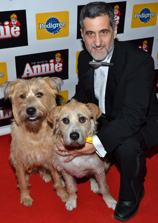 <p>Animal trainer Bill Berloni with <em>Annie</em> pups Casey and Sunny.</p>