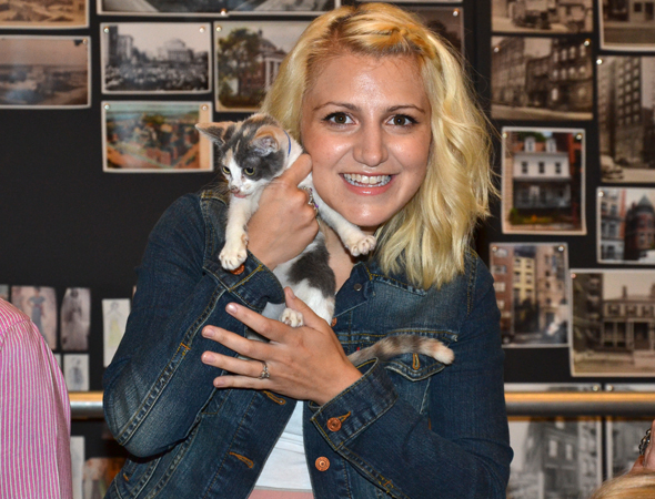 <p>Annaleigh Ashford gets close to one of the <em>tail</em>ented felines up for the role.</p><br />(© David Gordon)