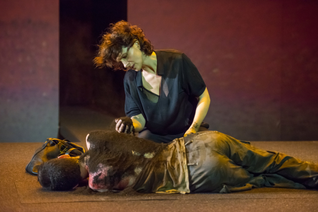 <p>Antigone (Juliette Binoche) buries her brother Polyneikes (Nathaniel Jackson).</p><br />(© Stephanie Berger)