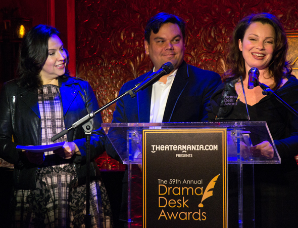 <p>As Kristen and Robert Lopez look on, Fran Drescher takes the podium.</p><br />(© David Gordon)