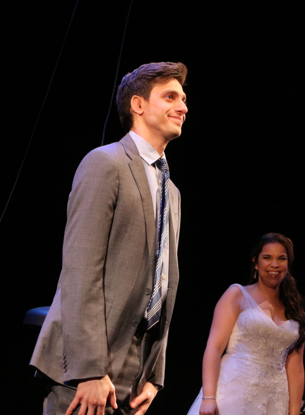 <p>As Lindsay Mendez looks on, Gideon Glick comes out for his curtain call.</p><br />(© David Gordon)