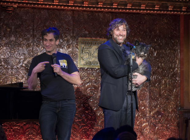 <p>As Seth Rudetsky looks on, Hugh Panaro shows a doggy named Loki, who currently plays Toto in the national tour of <em>The Wizard of Oz</em>.</p><br />(© Allison Stock)