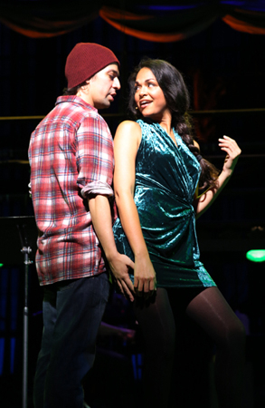 <p>As Susan, Karen Olivo gets cozy with Lin-Manuel Miranda, who plays Jon.</p><br />(© Joan Marcus)