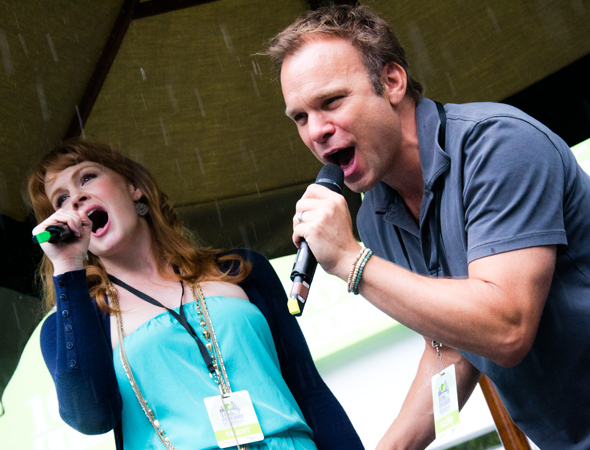 "<p>August 1: <em>Big Fish</em> stars Kate Baldwin and Norbert Leo Butz brave a torrential rainstorm to perform their big duet, ""Time Stops,"" for an eager crowd at Broadway in Bryant Park.</p><br />(© David Gordon)"