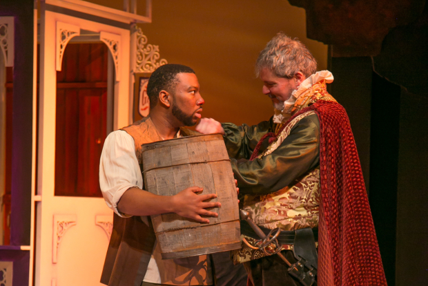 <p>Bardolph (Javon Johnson) is given a new trade as a tapster by Sir John Falstaff (David Andrew Macdonald).</p><br />(© Jerry Dalia)