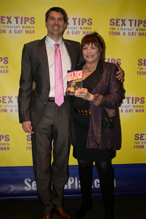 <p>Berman shows off her best-selling book, which inspired the production.</p><br />(© Stephanie Olsen)
