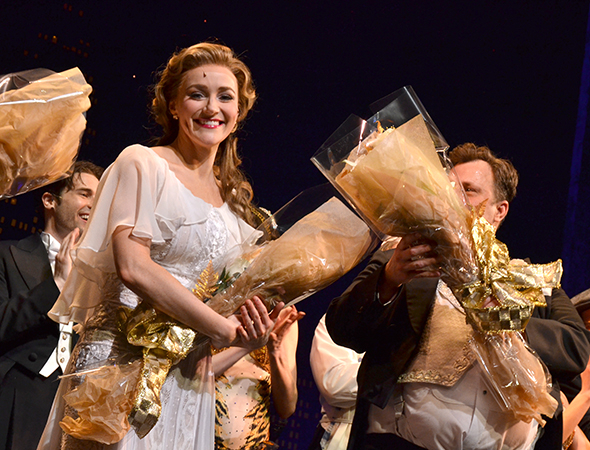 <p>Betsy Wolfe shows off her opening-night bouquet of flowers.</p><br />(© David Gordon)