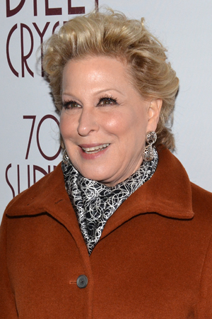<p>Bette Midler, who appeared with Billy Crystal in the 2012 film <em>Parental Guidance</em>, smiles for the cameras.</p><br />(© David Gordon)