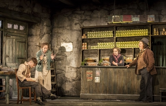 <p>Billy (Daniel Radcliffe), Kate (Ingrid Craigie), Eileen (Gillian Hanna), and Johnnypateenmike (Pat Shortt) gather at the shop.</p><br />(© Johan Persson)