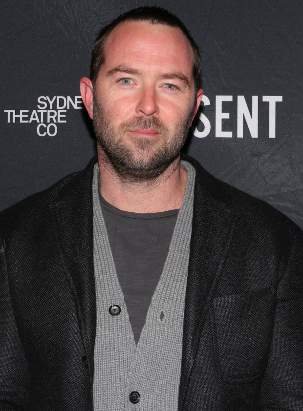 <p><em>Blindspot</em> star Sullivan Stapleton heads into the Ethel Barrymore Theatre.</p><br />(© David Gordon)
