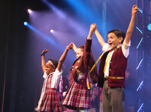 <p>Bobbi MacKenzie, Isabella Russo, and Luca Padovan excitedly take their bow. </p><br />(© David Gordon)