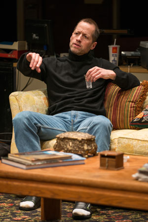 <p>Boris, played by Tim Hopper, settles in after his journey from Russia.</p><br />(© Michael Brosilow)