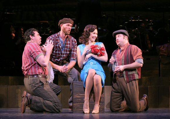 <p>Bradley Dean, Zachary James, and Brian Cali serenade Laura Benanti.</p><br />(© Joan Marcus)