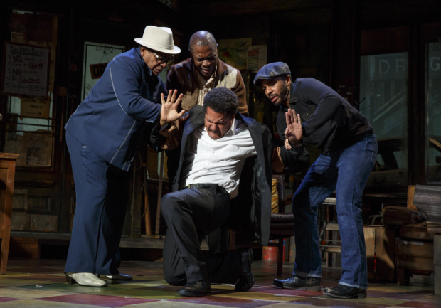 <p>Brandon J. Dirden in distress as Booster receives aide from Harvy Blanks as Shealy, Michael Potts as Turnbo, and André Holland as Youngblood.</p><br />(© Joan Marcus)