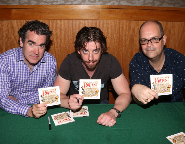 <p>Brian d&#39&#x3B;Arcy James, Christian Borle, and Brad Oscar show off their new <em>Something Rotten!</em> souvenir.</p><br />(© David Gordon)