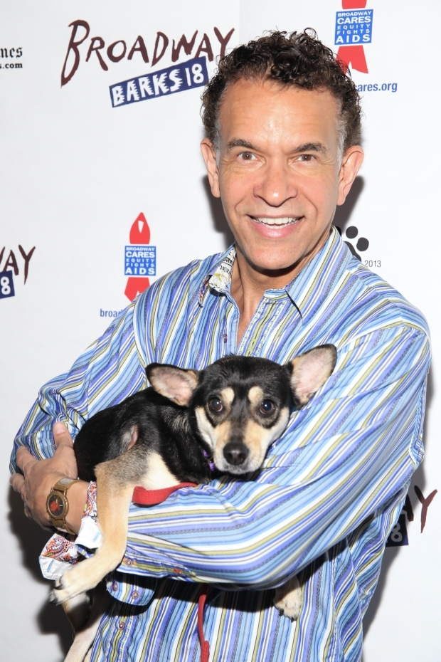 <p>Recent <em>Shuffle Along</em> star Brian Stokes Mitchell has a great time at Broadway Barks.</p><br />(© Tricia Baron)