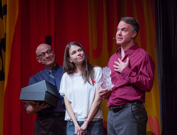 <p>Broadway Cares Executive Director Tom Viola and Tony winner Sutton Foster salute outgoing Producing Director Michael Graziano for two decades of dedication.</p><br />(© Seth Walters)