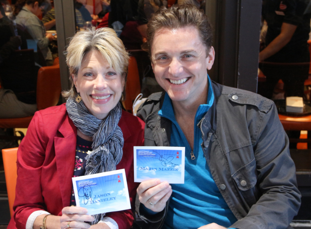 <p>Broadway couple Marin Mazzie and Jason Danieley smile for the cameras at the autograph table.</p><br />(© David Gordon)