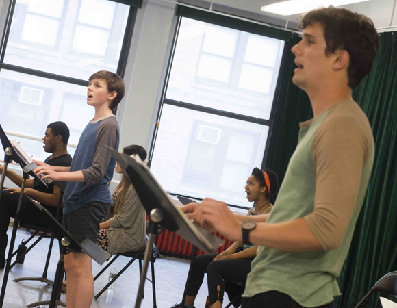 <p>Broadway Dreams Foundation students Sam Faulkner and Rico LeBron sing together.</p><br />(© Monica Simoes)
