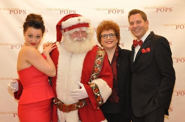 <p>Brown is joined by Santa Claus, Essential Voices USA director Judith Clurman, and conductor Reineke for a photo.</p><br />(© Genevieve Rafter Keddy)