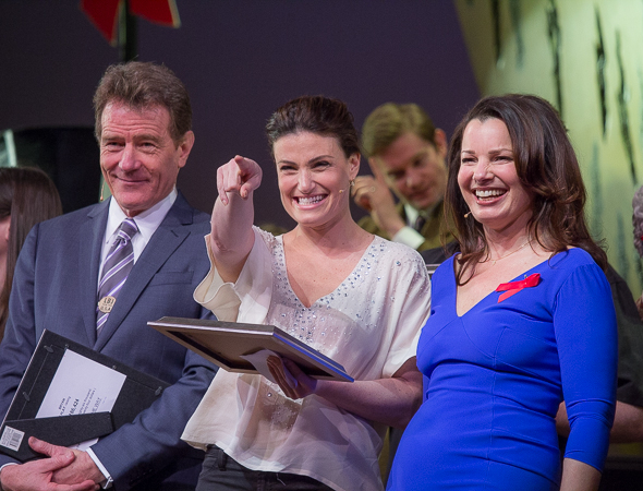 <p>Bryan Cranston, Idina Menzel, and Fran Drescher spot a winner in the crowd.</p><br />(© David Gordon)