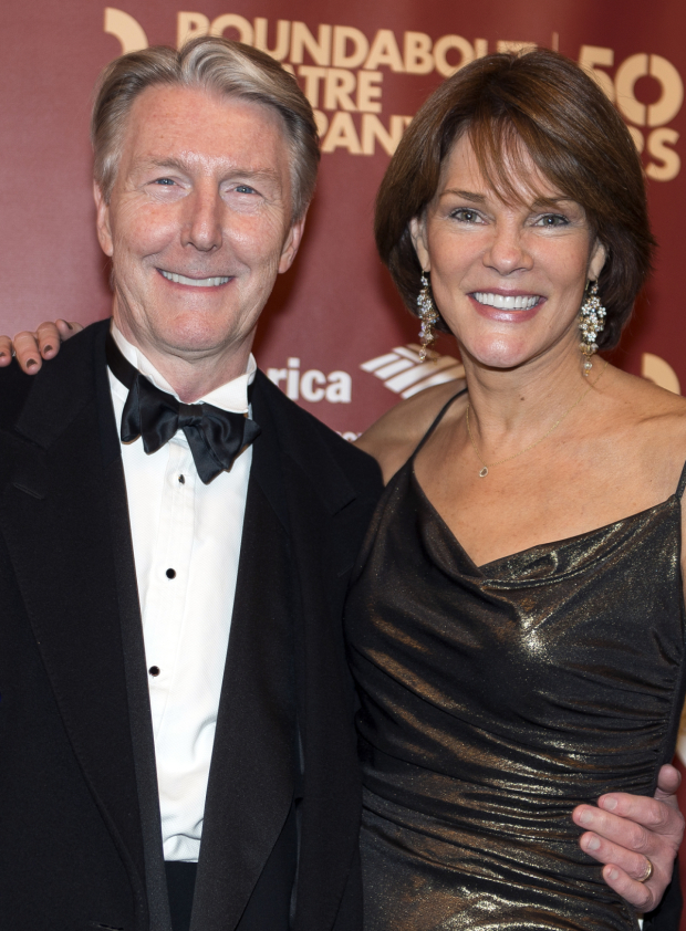 <p>Byron Jennings (posing with his wife, Carolyn McCormick) reprises his work as the Noel Coward-esque Beverly Carlton.</p><br />(© Allison Stock)