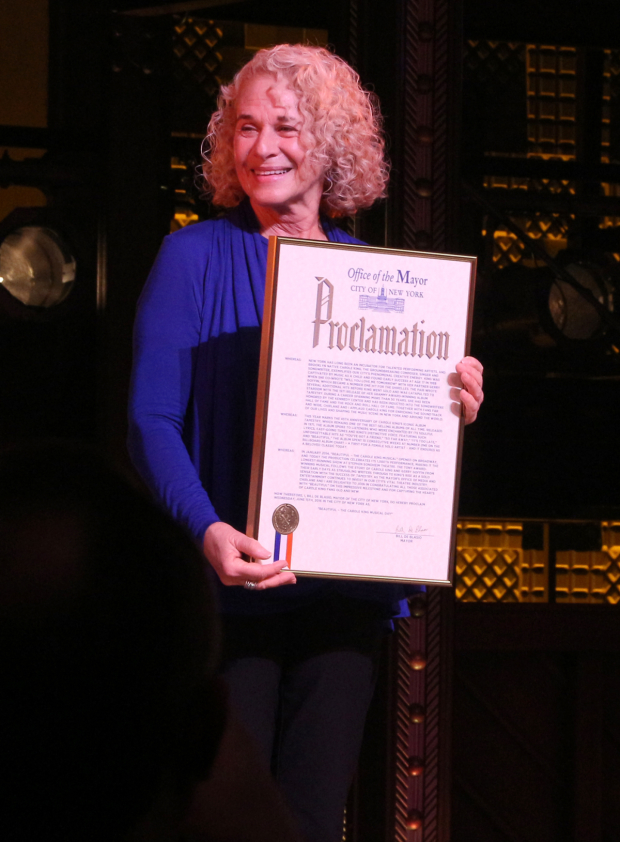 <p>Carole King receives a proclamation declaring it <em>Beautiful — The Carole King Musical</em> Day in New York City.</p><br />(© David Gordon)