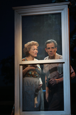 <p>Cass Morgan and Michael X. Martin snoop from the window as nosy neighbors Marge and Charlie. </p><br />(© Joan Marcus)