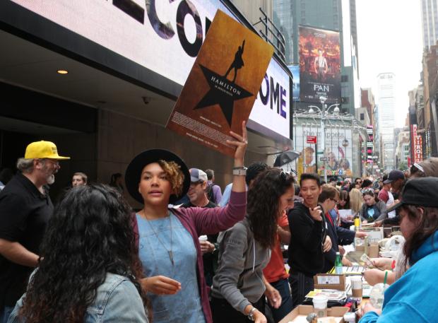 <p>Cast members from <em>Hamilton</em> sell show merch in Times Square.</p><br />(&copy&#x3B; David Gordon)