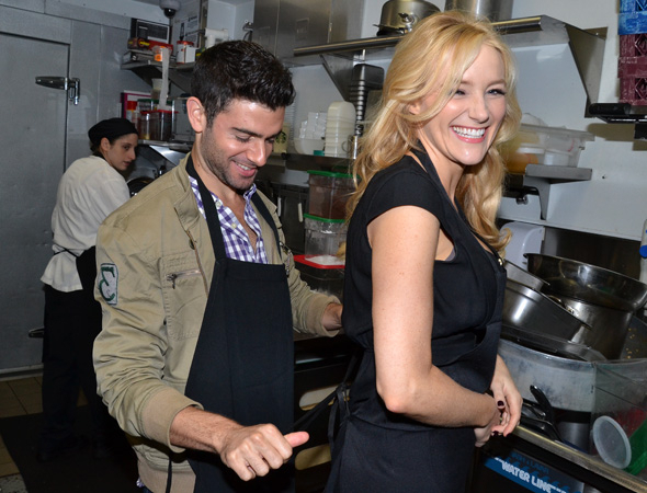 <p>Chef Adam Kantor lovingly ties Chef Betsy Wolfe&#39&#x3B;s apron strings.</p><br />(© David Gordon)
