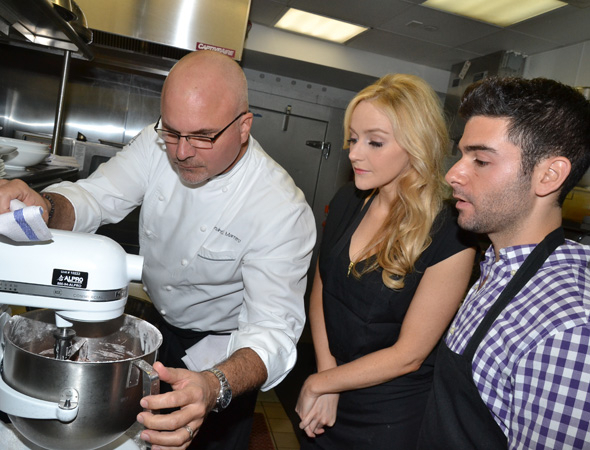 <p>Chef Betsy and Chef Adam are schooled by Chef André.</p><br />(© David Gordon)