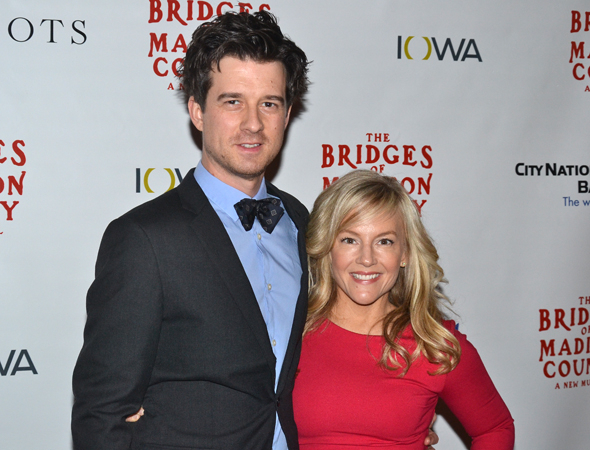 <p>Christian Hebel and Rachael Harris snuggle close before taking in the show.</p><br />(© David Gordon)