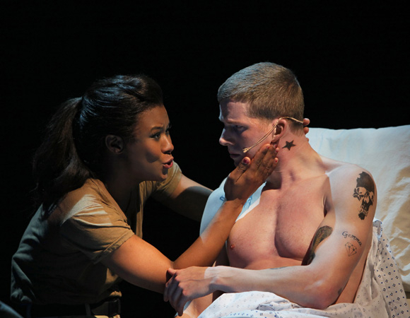 <p>Christina Sajous helps Stark Sands recover from his war wounds in <em>American Idiot</em> (2010).</p><br />(© Paul Kolnik)