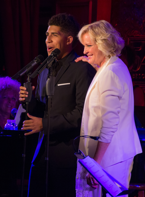 <p>Christine brings her son Elijah onstage to show off his beautiful voice.</p><br />(© Seth Walters)
