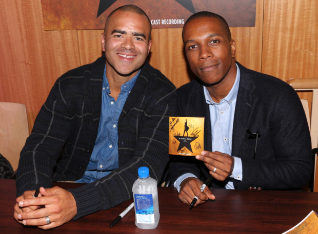 <p>Christopher Jackson and Leslie Odom Jr. proudly show off their new show swag.</p><br />(© David Gordon)