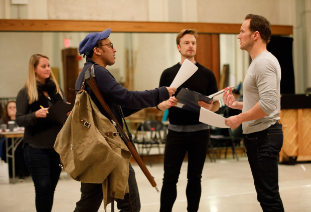 <p>Christopher Wheeldon (center) directs Aasif Mandvi (in hat) and Patrick Wilson (right).</p><br />(© Joan Marcus)