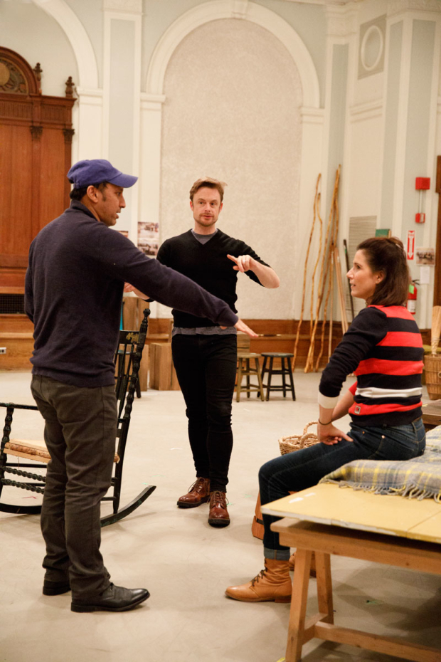 <p>Christopher Wheeldon (center) works with Aasif Mandvi (left) and Stephanie J. Block (right).</p><br />(© Joan Marcus)
