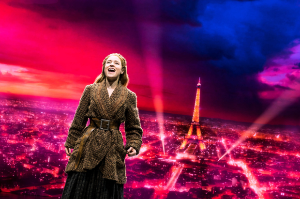 <p>Christy Altomare stands against a vibrant Paris skyline.</p><br />(© Matthew Murphy)