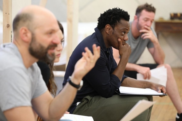 <p>The cast of <em>Othello</em> in rehearsal.</p><br />(© Joan Marcus)