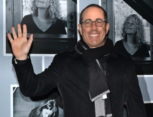<p>Comedian Jerry Seinfeld waves to the crowds on his way to see <em>Beautiful</em>.</p><br />(© David Gordon)