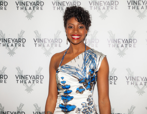 <p>Condola Rashad looks radiant on the red carpet. </p><br />(© Seth Walters)
