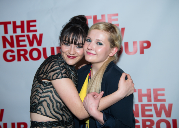 <p>Costars Isabelle Fuhrman and Abigail Breslin share an embrace.</p><br />(© Allison Stock)